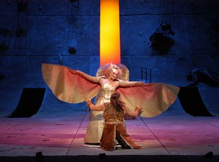 Kundry (W. Meier) disguised as a chicken attacks Parsifal (C. Ventris) in the Lehnhoff production