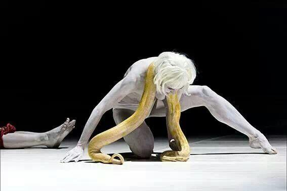 A dancer with live python, Parsifal in Bologna 2014